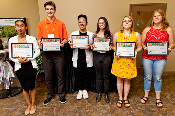 Six students demonstrating awards